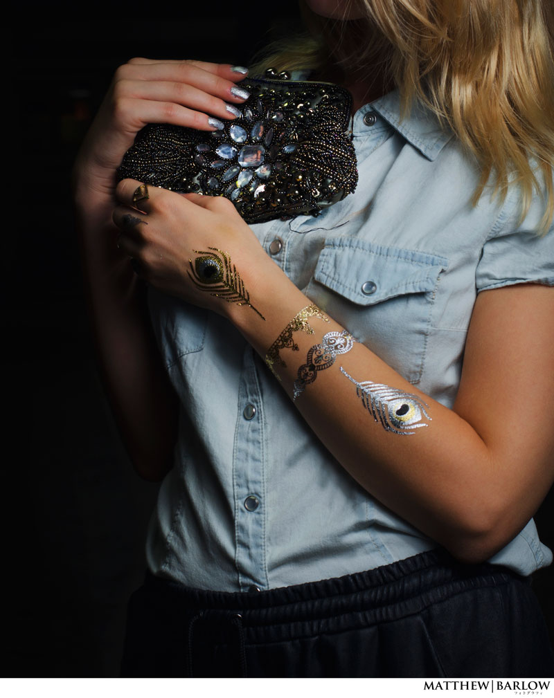 embellished clutch and metallic tattoos