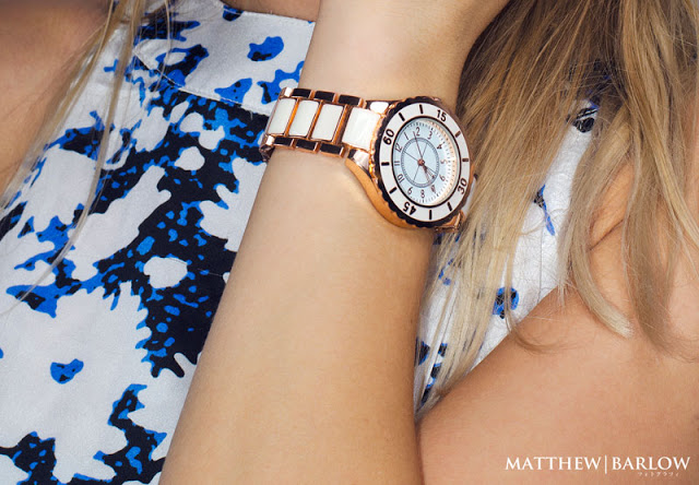 rose gold and white watch