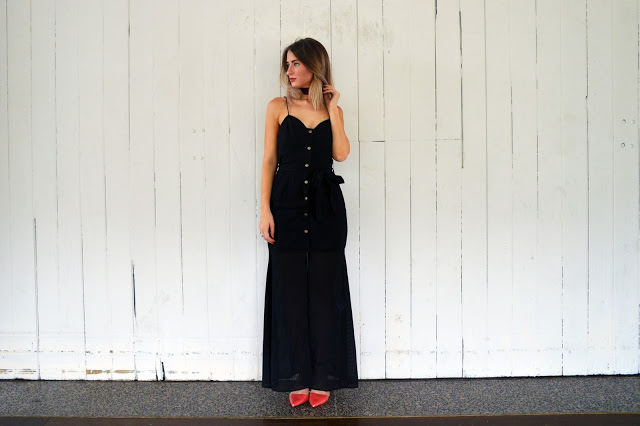 The Look: Black Maxi Dress With A Twist