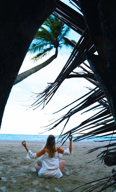 girl meditating on beach