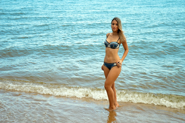 girl with an hour glass shape in triangl bikini on the beach