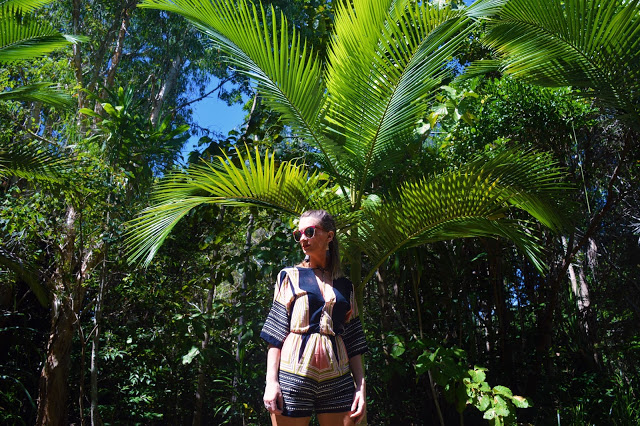 outfit shoot near tropical palm tree tribal playsuit