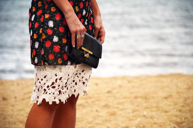 rose print slip dress layered over crochet floral white lace skirt on Summer beach