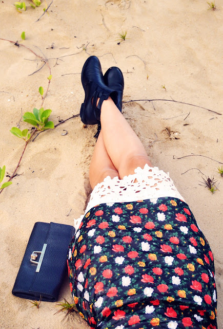 leg selfie of bare legs with black ankle boots. boho festival style on beach
