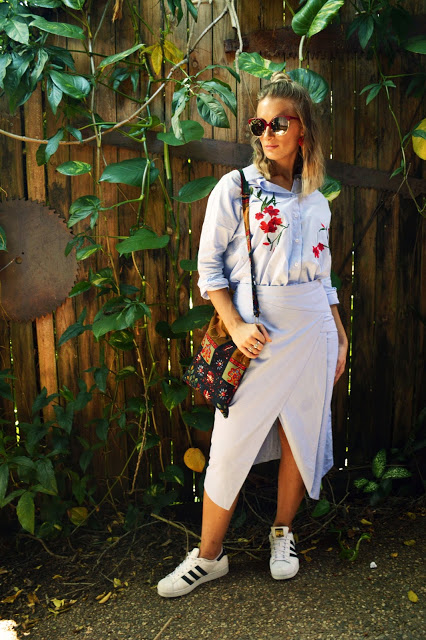 adidas superstars outfit with assymetric wrap skirt and floral embellished folk blouse street style summer