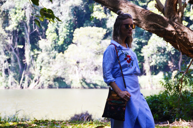 outfit shoot in the woods floral embellished stripe skirt worn with folk style bag and wrap skirt blogger outfit style