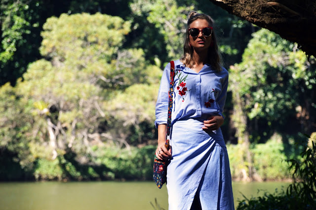fashion shoot in rainforest lake embroidered folk blouse with cameo wrap skirt blogger outfit the daily luxe