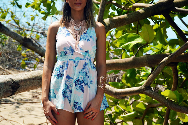 pink pastel floral playsuit on tropical beach styled with bohemian rose gold jewellery