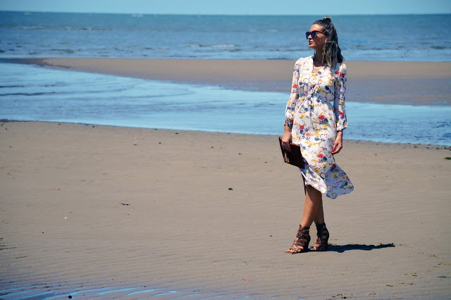 beach summer style floral midi dress with split worn with wedge heels and oversized sunglasses