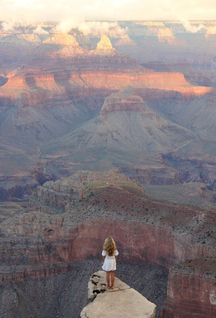 wanderlust girl standing in the grand canyon
