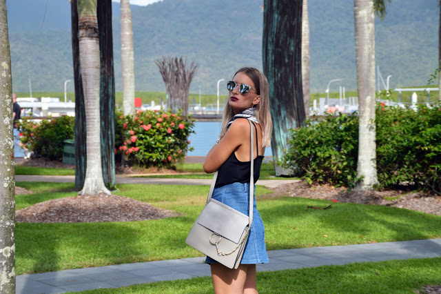 minimalist summer outfit with button up denim skirt lookalike chloe bag