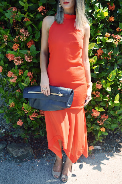honey and beau orange midi dress and mon purse oversized leather clutch