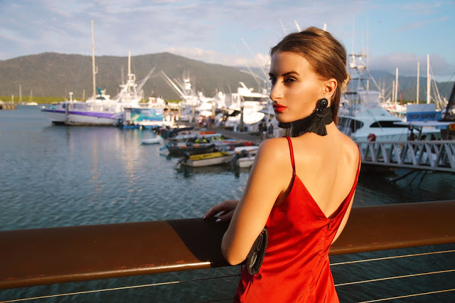 vintage style red low back slip dress with tassel earrings
