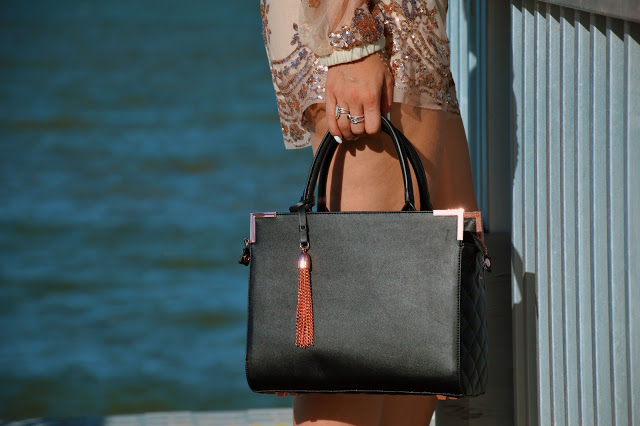 black oliver bilou handbag with rose gold tassel