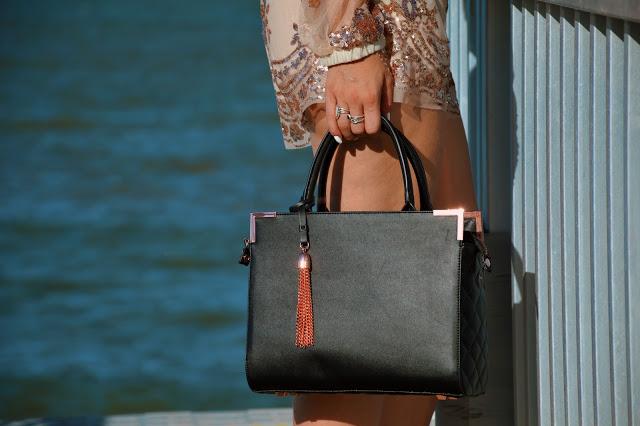 black oliver bilou handbag with rose gold tassel