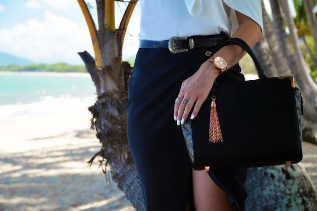 black handbag rose gold tassel