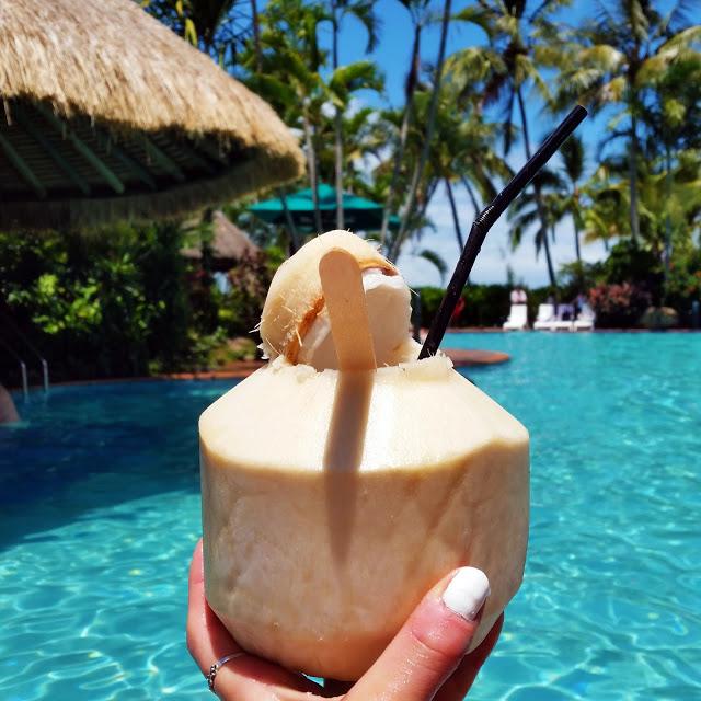pina colada in coconut at pool