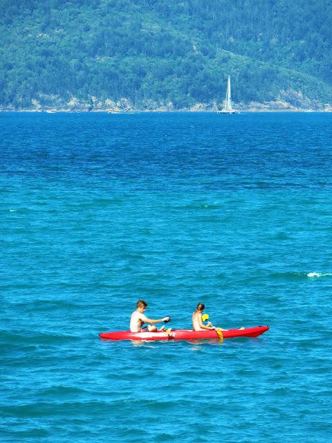 kayaking off catseye beach hamilton island