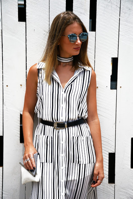 striped black and white shirt dress with monochrome clutch