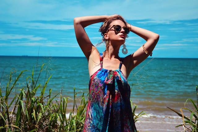 beach outfit idea boho print jumpsuit tie neck