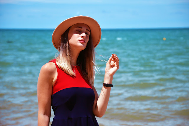 nautical outfit idea red and navy dress with fedora hat