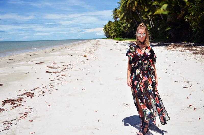 australian blogger on tropical beach wearing rose print maxi kimono western buckle belt lace up choker round sunglasses