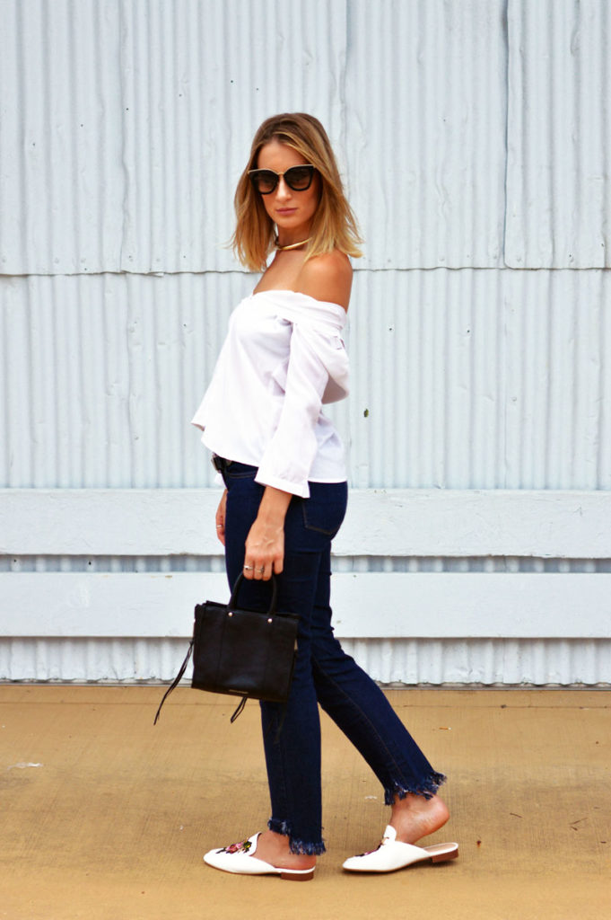 blogger street style outfit white button up shirt styled off shoulder