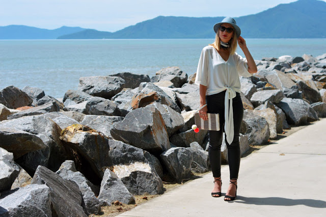 minimalist street style look outfit idea white shirt leather pants silk scarf
