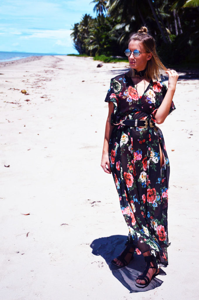 boho beach style girl on beach wearing rose print maxi kimono round sunglasses
