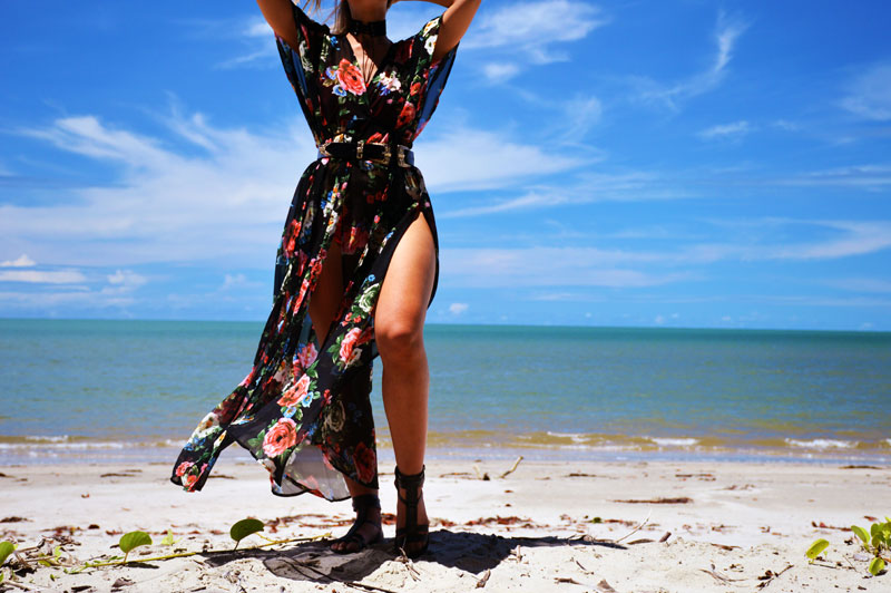 rose print floral maxi kimono with western buckle belt and lace up choker on beach with blue water