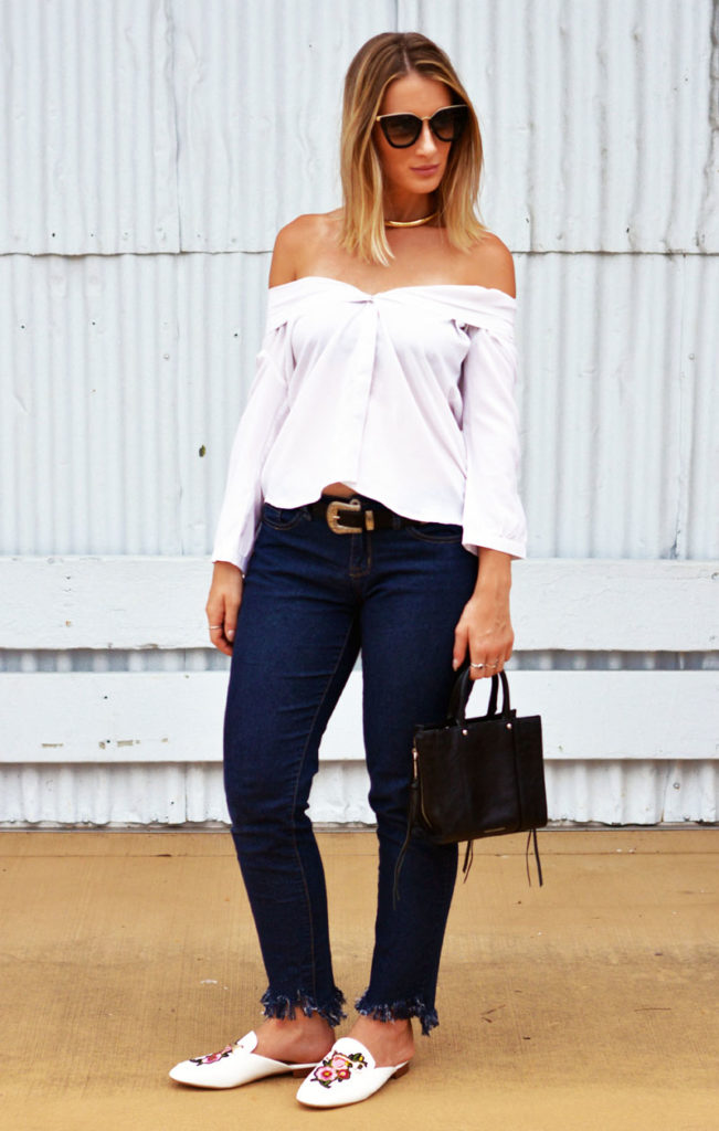 blogger street style outfit whit e button up shirt styled off shoulder fringe hem jeans embroidered loafers