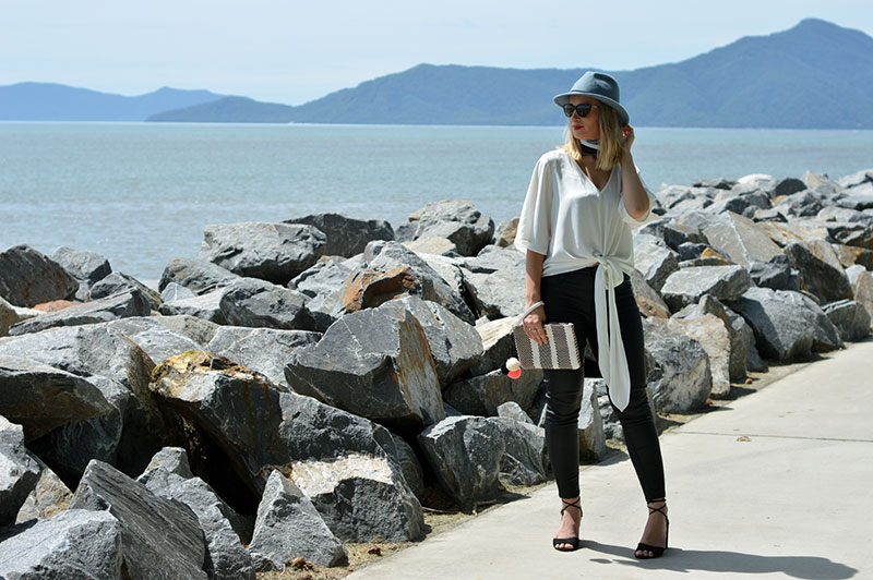 australian street style monochrome outfit leather pants white shirt black lace up heels