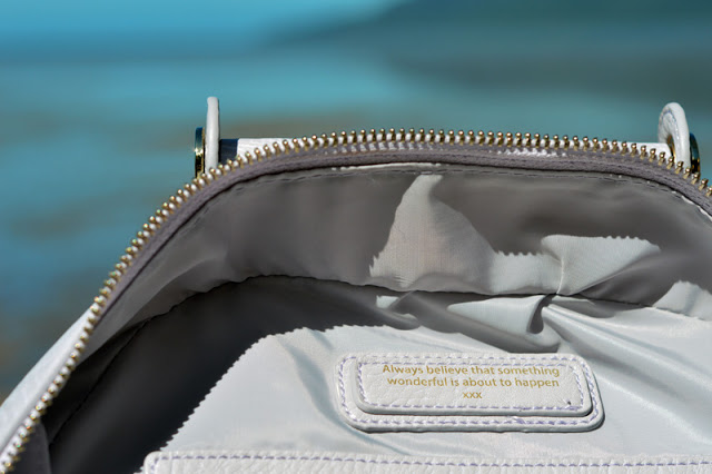 oliver bilou handbag with positive affirmation saying always believe that something wonderful is about to happen