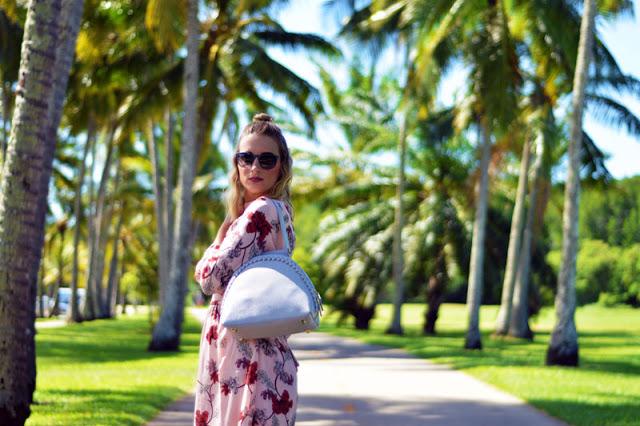blonde fashion blogger wearing floral blush dress with grey statement oliver bilou handbag