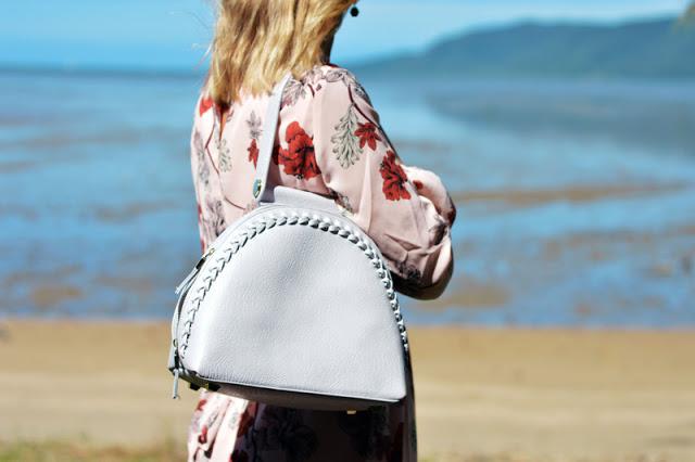 grey oliver bilou plaited statement handbag in front of summer ocean