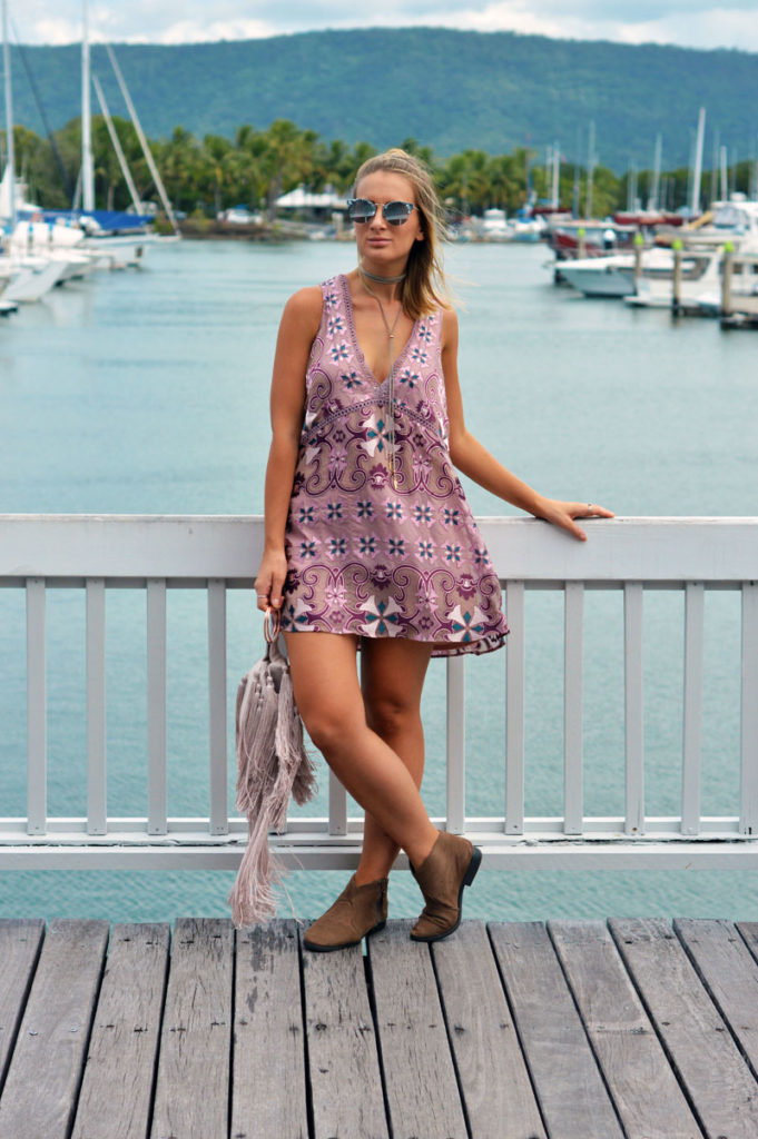 summer outfit boho print shift dress fringe clutch bag marble sunglasses suede ankle boots