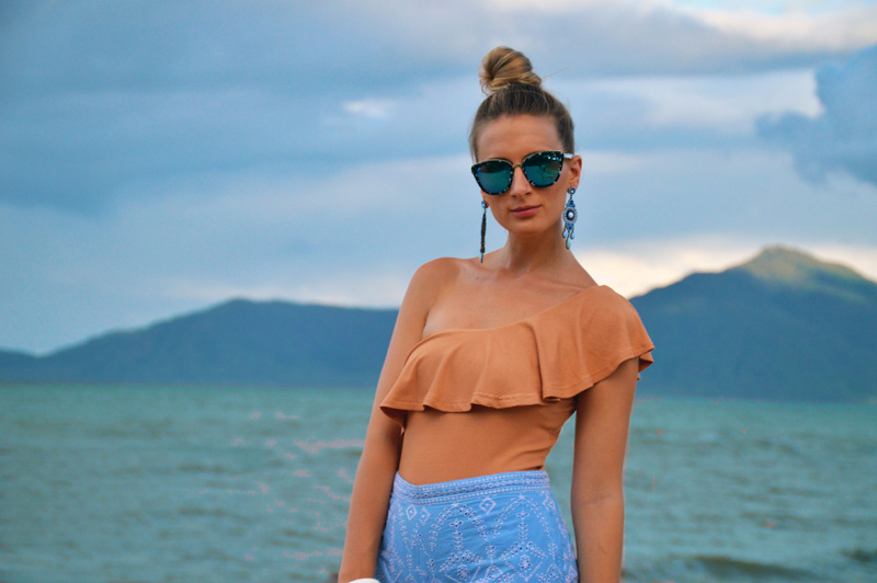 australian fashion blogger wearing frill one shoulder top embroidered top marble sunglasses
