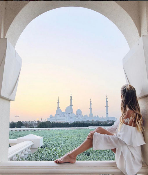ohh couture fashion blogger sat in front of abu dhabi palace