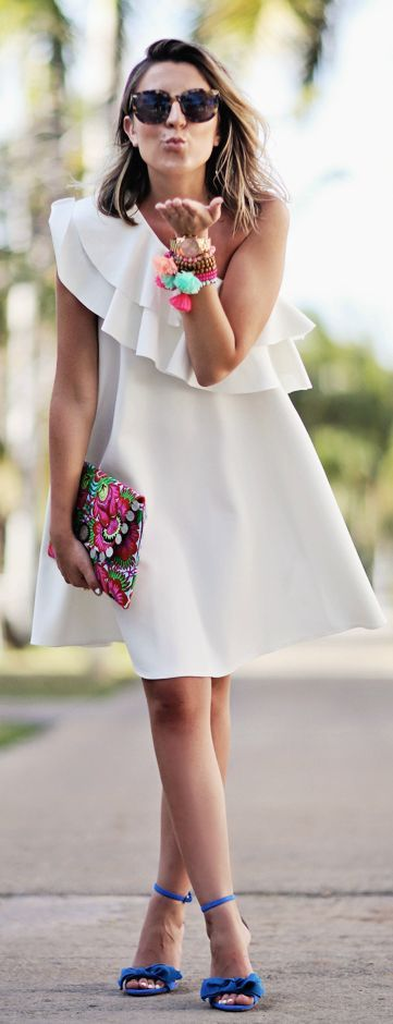white one shoulder dress and colourful accessories