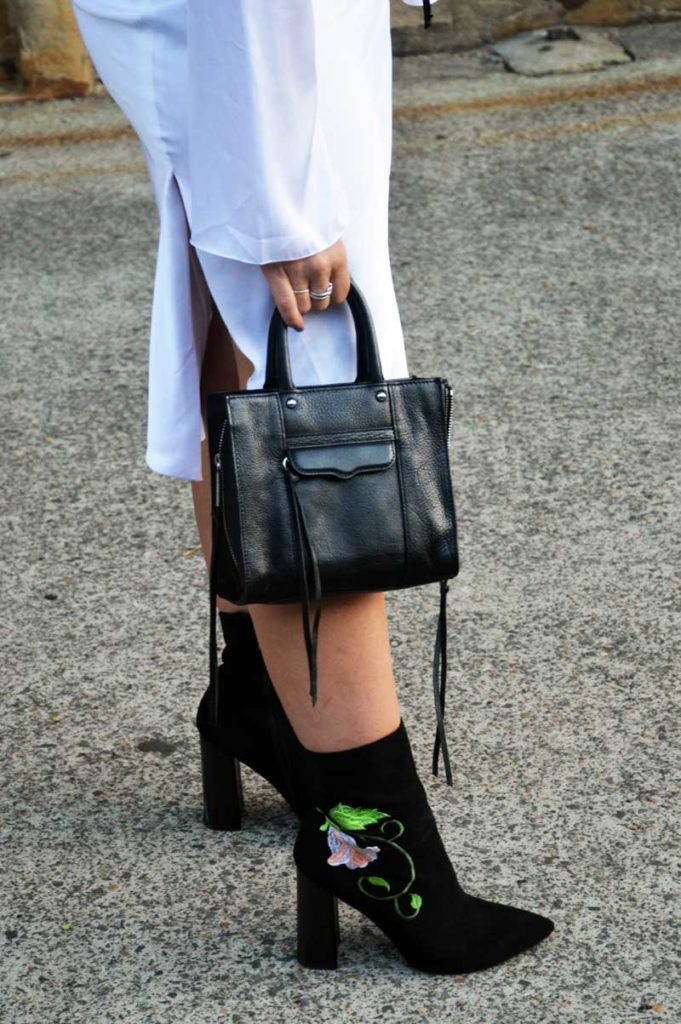 fashion week street style outfit details floral embroidered black velvet ankle boots and rebecca minkoff bag