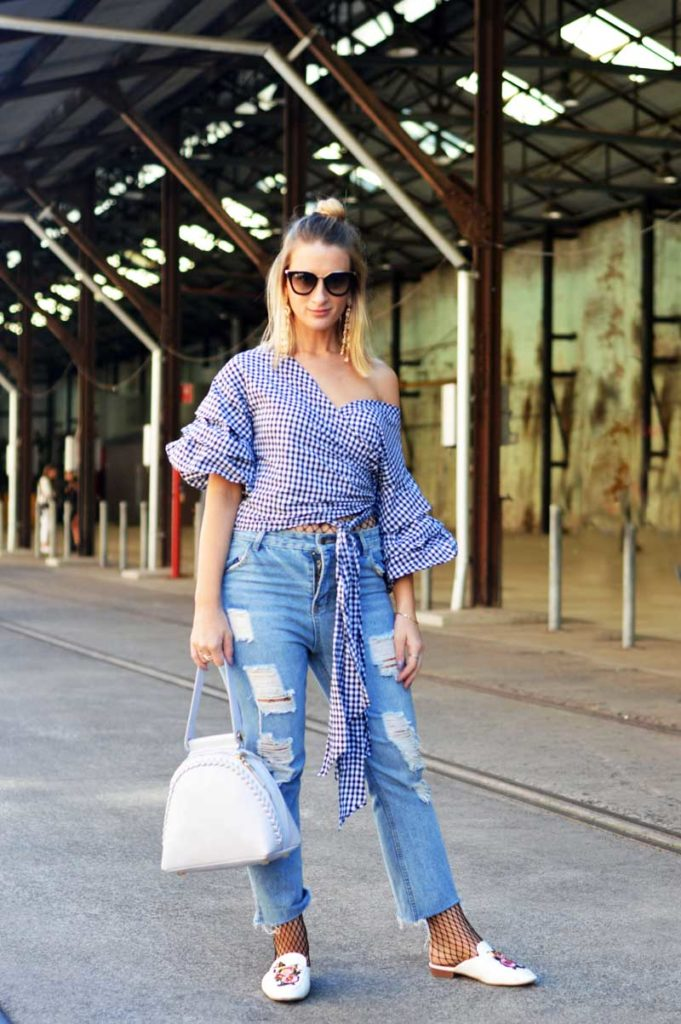mbfwa street style gingham off shoulder wrap blouse with ripped jeans fishnet tights and gucci style embroidered loafers