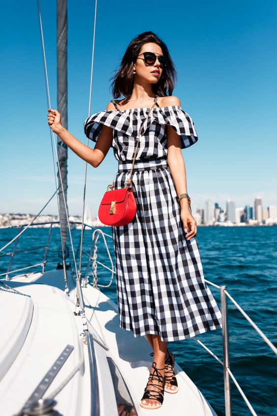 french riveria outfit style off shoulder gingham dress and red bag viva luxury
