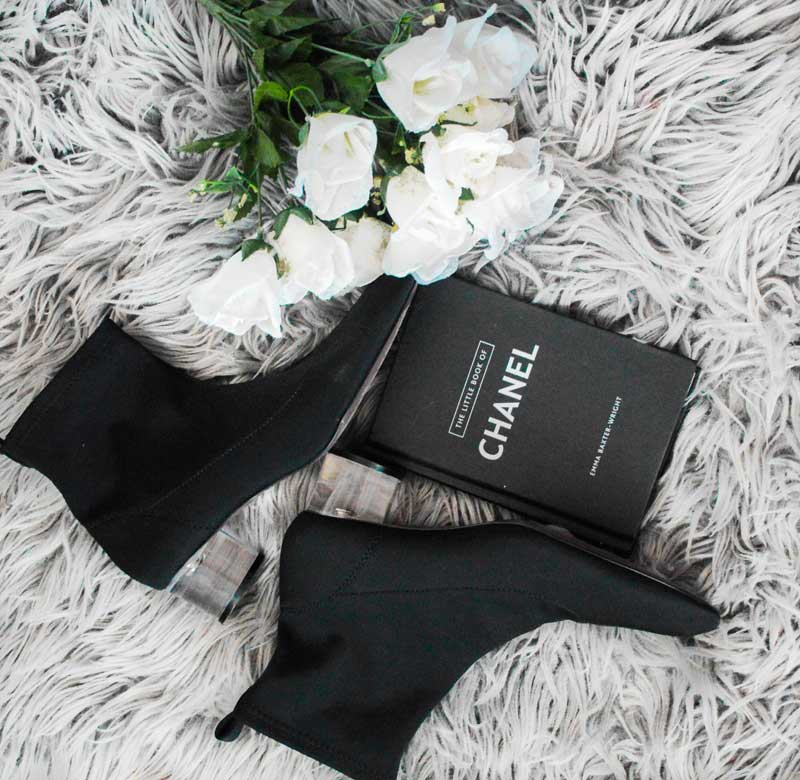 fashion flatlay zara black perspex heel sock boots chanel book