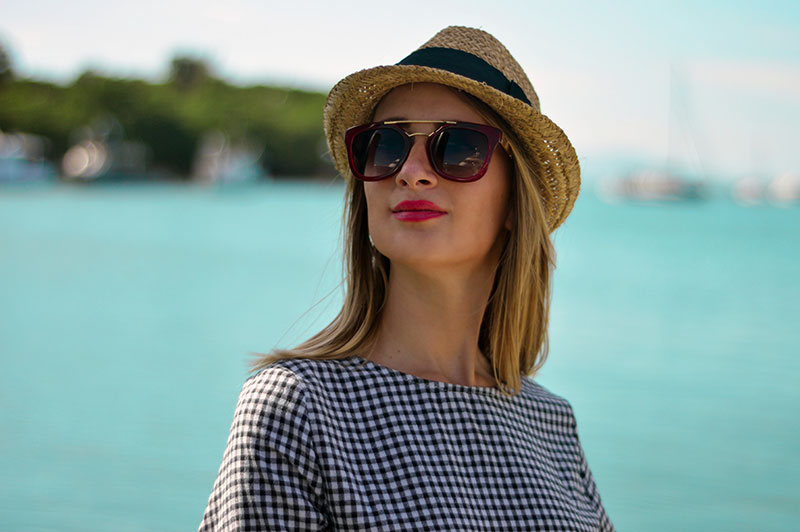 blonde blogger wearing red sunglasses straw hat gingham