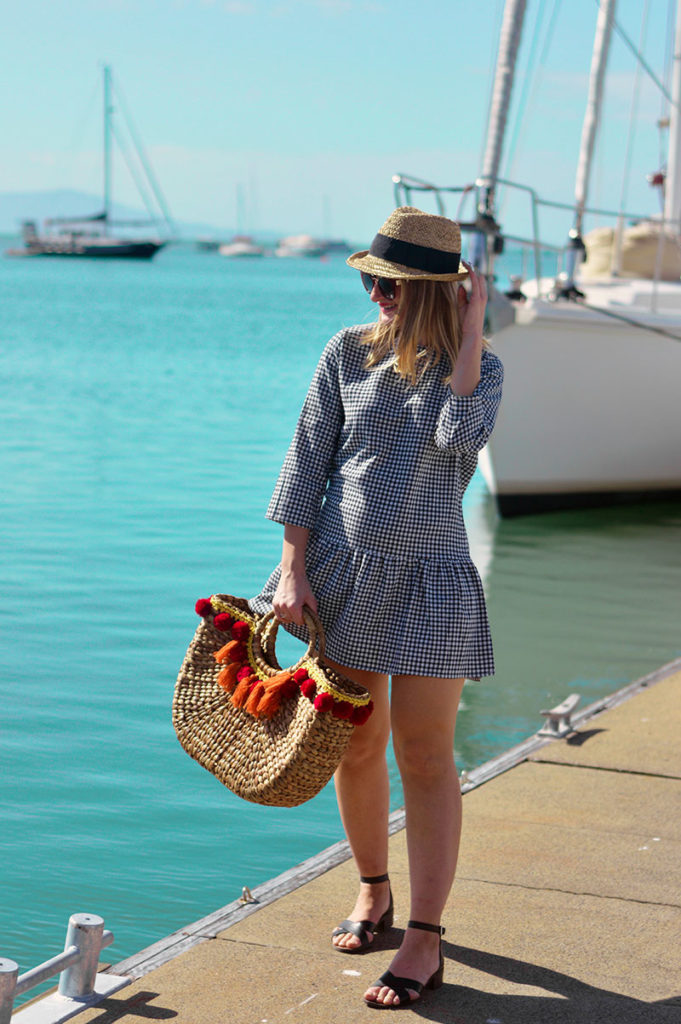 summer vacation outfit gingham dress wicker basket bag with pom poms straw hat from tk maxx