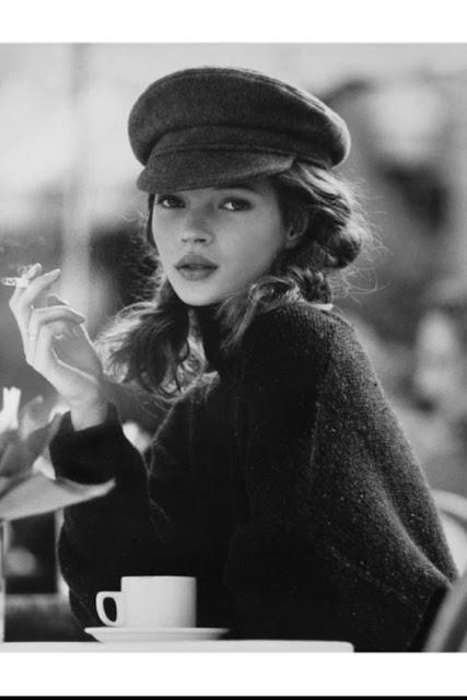 kate moss wearing a baker boy cap in the 1990s