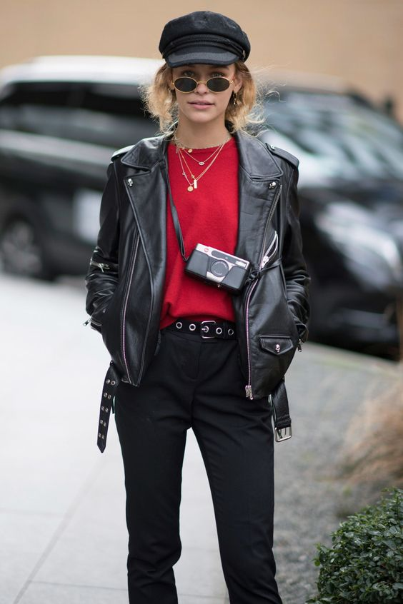 street style look with baker boy hat leather jacket retro sunglasses