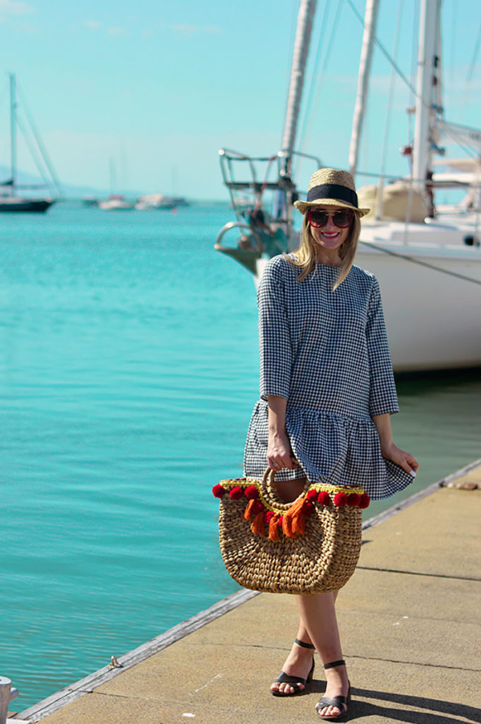 gingam summer outfit with wicker straw basket bag and straw hat