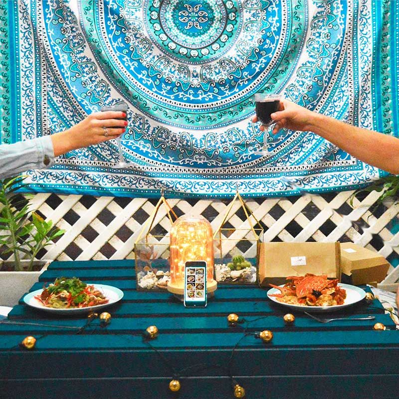 date night with ubereats seafood on diy wooden crate table with fairy lights and boho decor
