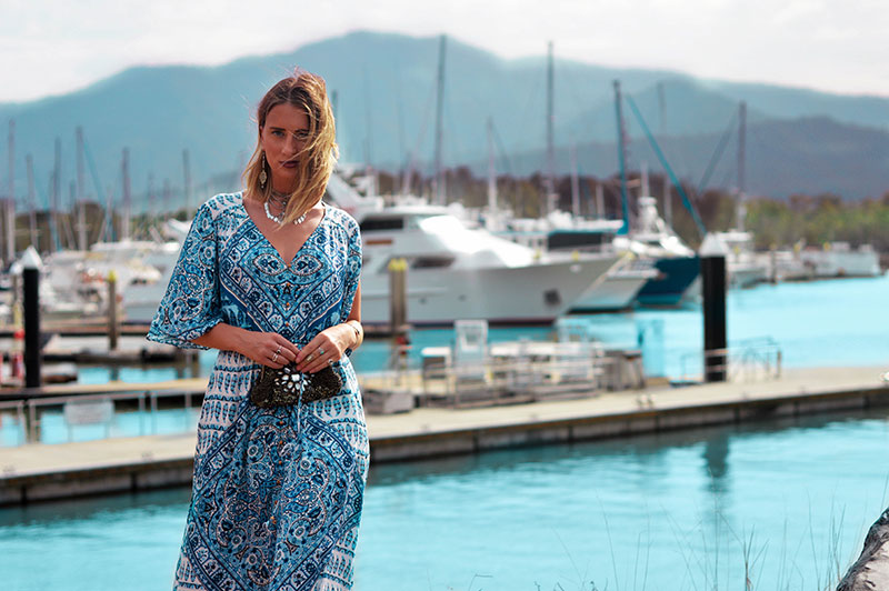 summer boho outfit idea chunky silver jewellery and blue boho printed maxi dress vacation holiday evening outfit